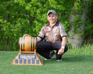 """Kurtis Barkley started the golf season just like he ended the last one. With a victory. The 2014 Ottawa Valley Golf Association Tournament of Champions winner survived the test of difficult playing conditions and a talented field of competitors to win the 2015 Flagstick Shootout on May 24th. Barkley, 27, fashioned an amazing start in round one of the tournament, posting a sparkling score of 69 (-3) when only one other player in the elite invited field managed to break par. A Smuggler's Glen Golf course playing hard and fast and swept by constant winds of over 40 km/h had competitors noting that the tournament might end up being nicknamed """"the slaughter at Smugglers"""". With calmer winds for the final round, a slough of players were looking to chase down Barkley, particularly those joining him in the last group on Sunday, past champion Dwight Reinhart and talented teen, Noah Steele. In the end though it was Barkley, a member of Cedar Glen Golf Club in Williamsburg, Ontario who bested the slate of players that included top amateurs and many talented collegians. The new champion sealed off the victory with a closing birdie on the 18th hole, for a final round of 74. His successful 30 foot putt ensured that Dwight Reinhart, looking at a 12 footer of his own for birdie, could not sink it to force a playoff. Reinhart had closed to within a stroke of Barkley with just one hole to play but it was something the champion was not even aware of. """"I had no idea, I was just playing my own game,"""" said Barkley. """"Fairways and greens was all I wanted and that's what I tried to do. I had a few drives that got away and cost me but I tried to make up for them."""" In earning his 143 (-1) total Barkley made just five bogies over the two rounds, remarkable considering that a litany of experience players who endured one disaster after another on the technically difficult Smuggler's Glen course. """"It's definitely challenging; you have to play smart. You have to hit a lot of fairways and greens to """